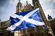 UNITED KINGDOM, London: 11 May 2015. The Scottish Saltire is pictured before the First Minister of Scotland, Nicola Sturgeon arrives out side of the House's of Parliament with all 56 newly elected Scottish National Party MP's out side the House's of Parliament for a photo-call. London, England. Andrew Cowie / Story Picture Agency