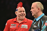 Peter Wright  in good spirits during the Betway Premier League Darts at the Manchester Arena, Manchester, United Kingdom on 23 March 2017. Photo by Mark Pollitt.