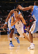 Oct. 22 2010; Phoenix, AZ, USA; Phoenix Suns guard Goran Dragic (2) drives the ball during the first half against Denver Nuggets power forward Shelden Williams (23) during a preseason game at the US Airways Center. Mandatory Credit: Jennifer Stewart-US PRESSWIRE.