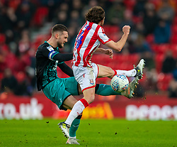 STOKE-ON-TRENT, ENGLAND - Saturday, January 25, 2020: Swansea City's captain Matt Grimes (L) and Stoke City's Joe Allen during the Football League Championship match between Stoke City FC and Swansea City FC at the Britannia Stadium. (Pic by David Rawcliffe/Propaganda)