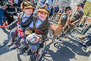 "Jonty, 3 and his sister Poppy, 7, await the start. The Tweed Run 2015 - it's 7th annual British public bicycle ride through London's historic streets, with a prerequisite that participants are dressed in their best tweed cycling attire. There are also plenty of handle bar moustaches, penny farthings and Union Jacks. ""Guests can expect a leisurely day cycling, stopping at some of London's most iconic landmarks to enjoy a spot of tea, a picnic in the park and finally a jolly good knees-up in a beautiful art-deco ballroom for the Tweed Run closing ceremony. Starting at Trafalgar Square, the cyclists then embarked on a 12 mile scenic ride through London, stopping at traditional spots."