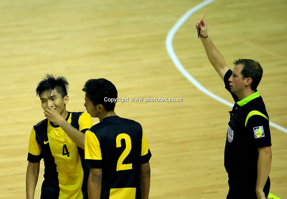 Malaysia's Shamsul Zamri is sent for an early shower after recieving his 2nd yellow card. OFC Futsal Championship Invitational 2013, Match Day Two, Malaysia v New Zealand, The Trusts Arena, Auckland, New Zealand, Wednesday 24th July 2013. Photo: Shane Wenzlick