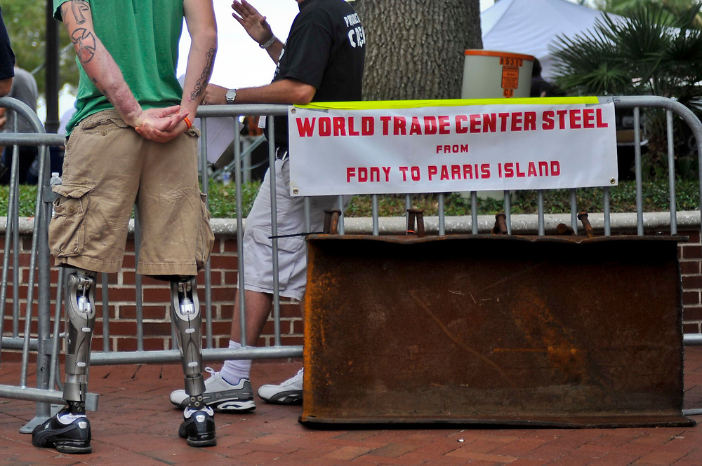 A metal piece from the World Trade Center. Justin, ( green t-shirt ) a wounded vet who join us for this w/e trip. Lt. Dan Band Weekend2 Beaufort, South Carolina. Sep 16, 2011.