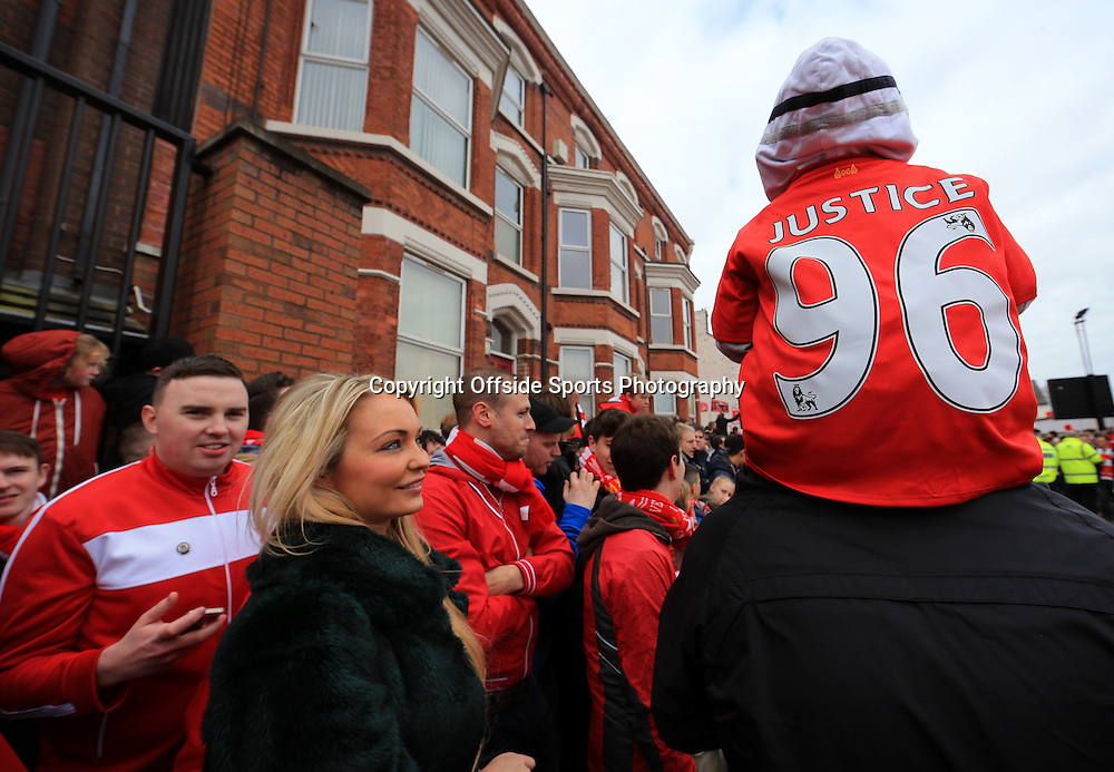 13th April 2014 - Barclays Premier League - Liverpool v Manchester City - A young boy wearing a Liverpool shirt with 'Justice' and the number 96 on the back, in reference to the Hillsborough disaster, sits on his father's shoulders - Photo: Simon Stacpoole / Offside.