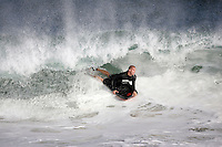 20 June 2006:  Boarder rides a tube in the South swell reaches the famous surf spot in Newport Beach, CA called The Wedge.  Surfers, boogie boarders, body surfers and crowds gather to watch the powerful waves and the waters take shape into unique sets along the jetty in Orange County, California.