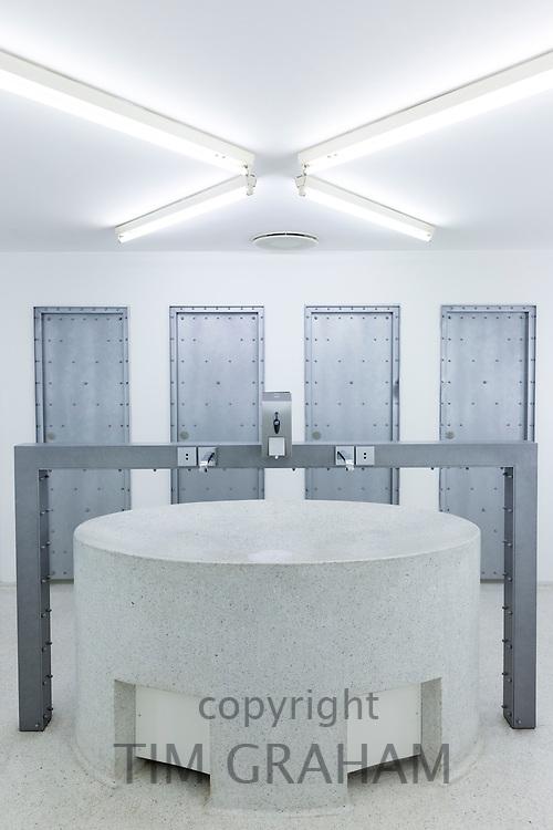 Minimalist modern Gents lavatory toilets and wash basin at Arken Museum of Modern Art near Copenhagen, Denmark