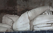 Funerary monument of Charles IV of Anjou, Count of Maine, 1472, by Francesco Laurana, marble effigy lying atop an antique sarcophagus, in the Cathedrale Saint-Julien du Mans or Cathedral of St Julian of Le Mans, Le Mans, Sarthe, Loire, France. Charles IV wears a crown and armour with the fleur de lys and coat of arms of Maine. The cathedral was built from the 6th to the 14th centuries, with both Romanesque and High Gothic elements. It is dedicated to St Julian of Le Mans, the city's first bishop, who established Christianity in the area in the 4th century AD. Picture by Manuel Cohen