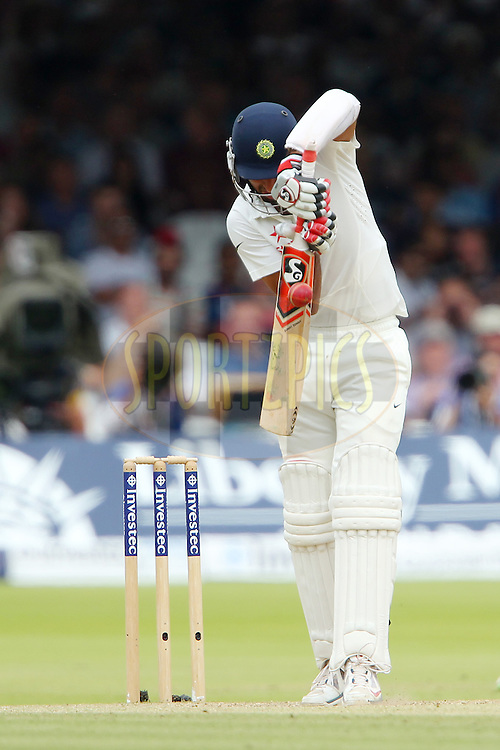 Cheteshwar Pujara of India during day three of the 2nd Investec test match between England and India held at Lords cricket ground in London, England on the 19th July 2014<br /> <br /> Photo by Ron Gaunt / SPORTZPICS/ BCCI