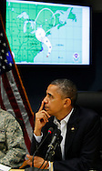 President Barack Obama listens to a briefing on Hurricane Sandy at FEMA Headquarters in Washington, DC on October 28, 2012.  Dennis Brack...