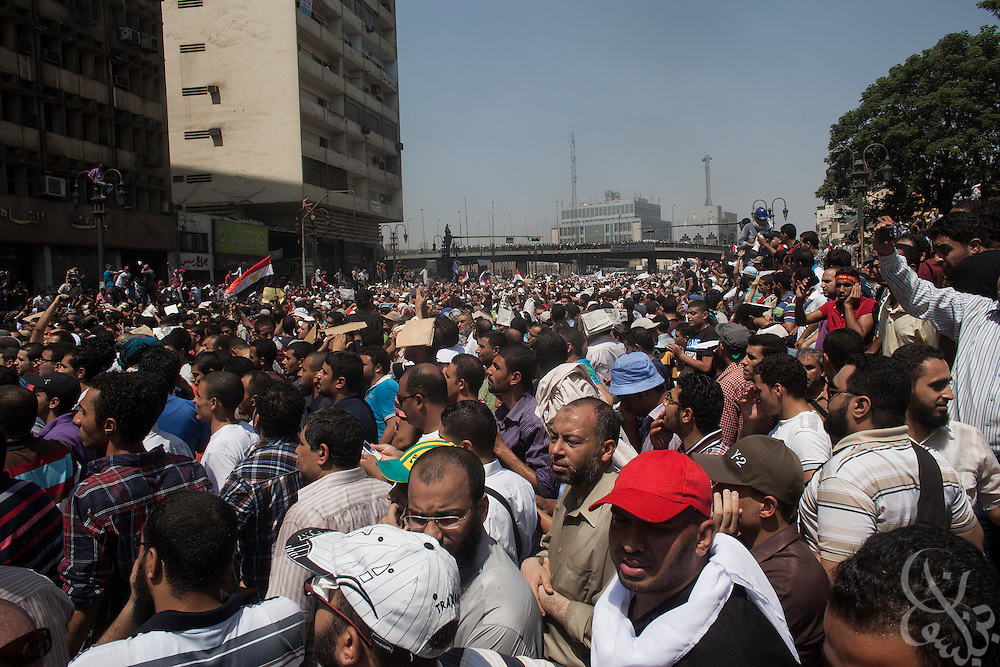 """Supporters of deposed Egyptian President Mohamed Morsi rally after Friday prayers in Ramsis Square during the August 16, 2014 """"Day of Rage"""" protests in Cairo, Egypt."""