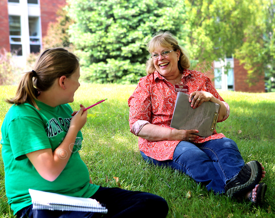 Co-cordinator Deborah Meister talks with a student during the Chippewa River Writing Camp photo by Emily Mesner