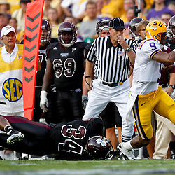 Sep 18, 2010; Baton Rouge, LA, USA;  LSU Tigers quarterback Jordan Jefferson (9) breaks away from Mississippi State Bulldogs linebacker K.J. Wright (34) during the first half at Tiger Stadium.  Mandatory Credit: Derick E. Hingle