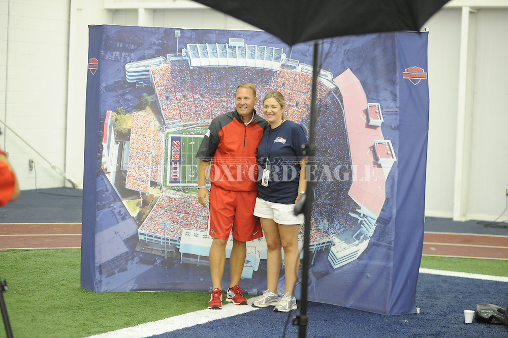Ole Miss head coach Hugh Freeze (left) poses with Meredith Johnson at the Ladies Football Forum at the University of Mississippi in Oxford, Miss., on Saturday, July 20, 2013.