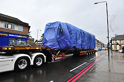 © Licensed to London News Pictures. 12/11/2016. The damaged Croydon tram is transported along West Wickham, High Street this morning.<br /> Recovery work continued throughout the night to lift the damaged tram from the tracks.  Photo credit : Grant Falvey/LNP