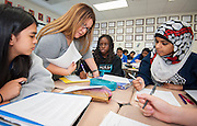 Sandra Rodriguez helps students in her world geography class at Debakey High School, April 25, 2013.