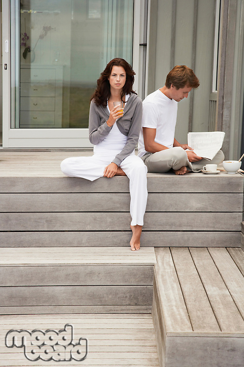 Couple having breakfast on porch