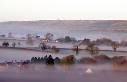 © Licensed to London News Pictures. 25/12/2019. Shepton Mallet, UK. A bright, mist covered landscape at Sunrise on Christmas Day in Shepton Mallet, Somerset.  Photo credit: Jason Bryant/LNP