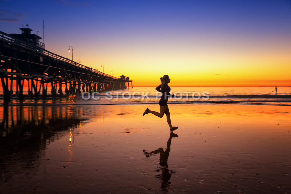 Jogging at Low Tide During Sunset at the San Clemente Pier