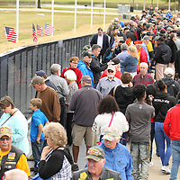 Thousands of area resdients get their first look at the replecia Vietnam Memorial Wall that opened Thursday morning at Veterans park in Tupelo.