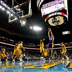 February 5, 2011; New Orleans, LA, USA; Los Angeles Lakers power forward Pau Gasol (16) shoots New Orleans Hornets during a game at the New Orleans Arena. The Lakers defeated the Hornets 101-95.  Mandatory Credit: Derick E. Hingle