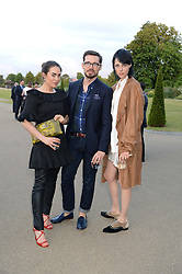 Left to right, TALLULAH HARLECH, ERDEM MORALIOGLU and EDIE CAMPBELL at the Fashion Rules Exhibition Opening at Kensington Palace, London W8 on 4th July 2013.