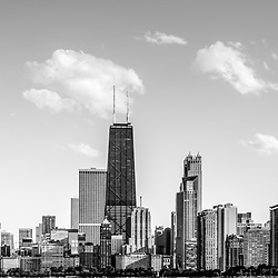 Chicago skyline panorama photo of North Chicago Streeterville with John Hancock Building and city skyscrapers. The John Hancock Center is one of the world's tallest skyscrapers and is a famous fixture in the Chicago skyline. Photo has a panoramic ratio of 1:3. Image Copyright © 2012 Paul Velgoswith All Rights Reserved.