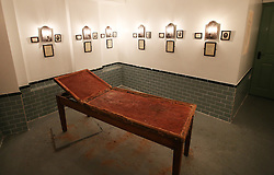 © Licensed to London News Pictures. 04/10/2015. London, UK. Photographs of the victims line the walls in a recreation of a mortuary inside the Jack the Ripper Museum.  A planned protest was cancelled at the museum today. Photo credit: Peter Macdiarmid/LNP