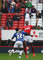 Charlton Athletic's Leon Cort beats Doncaster Rovers' Theo Robinson to the ball  - Photo mandatory by-line: Robin White/JMP - Tel: Mobile: 07966 386802 24/08/2013 - SPORT - FOOTBALL - The Valley - Charlton -  Charlton Athletic V Doncaster Rovers - Sky Bet League Two