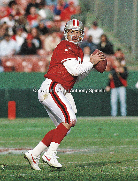 San Francisco 49ers quarterback Steve Young (7) drops back to pass during the NFL football game against the Denver Broncos on Dec. 17, 1994 in San Francisco. The 49ers won the game 42-19. (©Paul Anthony Spinelli)