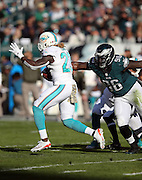 Miami Dolphins running back Jay Ajayi (23) eludes a tackle attempt by Philadelphia Eagles nose tackle Bennie Logan (96) as he runs with the ball during the 2015 week 10 regular season NFL football game against the Philadelphia Eagles on Sunday, Nov. 15, 2015 in Philadelphia. The Dolphins won the game 20-19. (©Paul Anthony Spinelli)