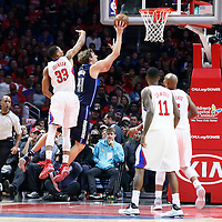 23 December 2016: Dallas Mavericks forward Dirk Nowitzki (41) goes for the layup past LA Clippers forward Wesley Johnson (33) during the Dallas Mavericks 90-88 victory over the LA Clippers, at the Staples Center, Los Angeles, California, USA.