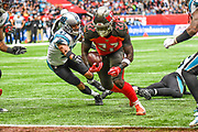 Tampa Bay Buccaneers Running BackRonald Jones (27) dives to touchdown under pressure from Carolina Panthers Defensive Back Ross Cockrell (47) during the International Series match between Tampa Bay Buccaneers and Carolina Panthers at Tottenham Hotspur Stadium, London, United Kingdom on 13 October 2019.