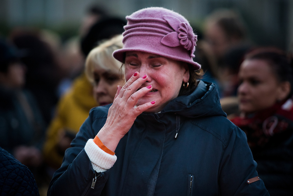 A woman weeps  outside of Colectiv nightclub, a rock club that was the site of a deadly fire, on November 8, 2015 in Bucharest, Romania.