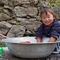 A girl washing her clothes, somewhere between Lukla and Phakding.