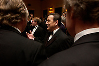 """20 NOV 2003, NEW YORK/USA:<br /> Gerhard Schroeder, SPD, Bundeskanzler, im Gespraech mit Spitzenvertretern der Wirtschaft, waehrend einem Empfang vor einer Festveranstaltung des American Institute for Contemporary German Studies anl. der Verleihung des """"Global Leadership Awards"""" Hotel Grand Hyatt at Grand Central<br /> IMAGE: 20031120-03-016<br /> KEYWORDS: Gerhard Schröder, U.S.A., Reise, Smoking<br /> Gespräch"""