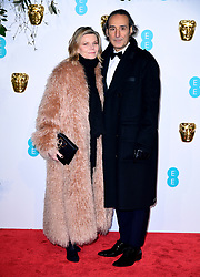 Alexandre Desplat and Dominique Lemonnier attending the 72nd British Academy Film Awards held at the Royal Albert Hall, Kensington Gore, Kensington, London.