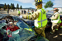 Kootenai County firefighters Maurice Wagner, center, Lt. Bryan Williams tend to mock accident victim Marlene Porter during a mass casualty drill Wednesday in Post Falls. The drill was conducted to test participant's capabilities to work with agencies they do not regularly interact.