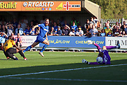 Bristol Rovers goalkeeper Anssi Jaakkola (32) saving from AFC Wimbledon midfielder Scott Wagstaff (7) during the EFL Sky Bet League 1 match between AFC Wimbledon and Bristol Rovers at the Cherry Red Records Stadium, Kingston, England on 21 September 2019.