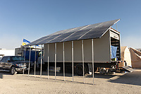 Large solar array that also functions as a shade structure.