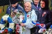 Carol Buckell on behalf of The Relatives of Fallen Players prepares to lay a wreath ahead of the EFL Sky Bet Championship match between Reading and Luton Town at the Madejski Stadium, Reading, England on 9 November 2019.