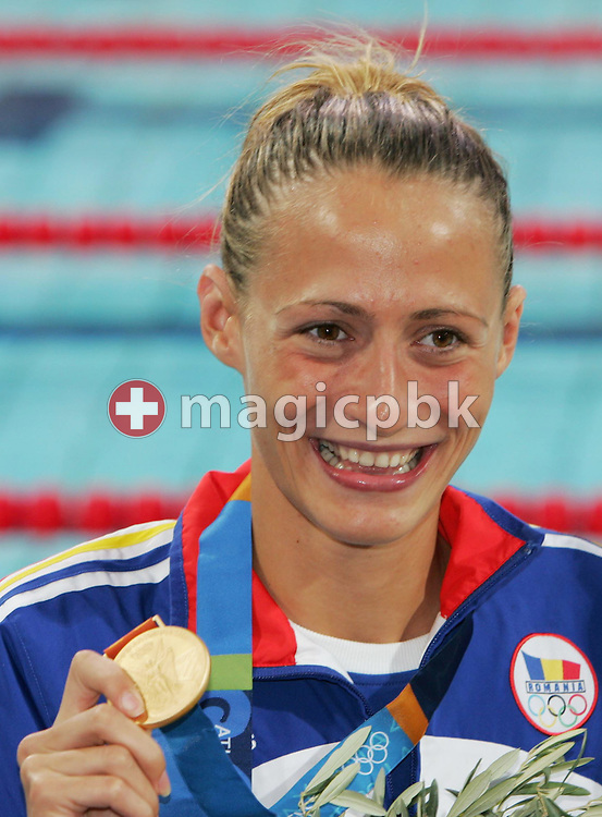 Camelia Potec from Romania shows her gold medal during the medal ceremony for the women's 200m Freestyle final at the Athens Olympic Aquatic Centre, Tuesday 17 August 2004.     (Photo by Patrick B. Kraemer / MAGICPBK)