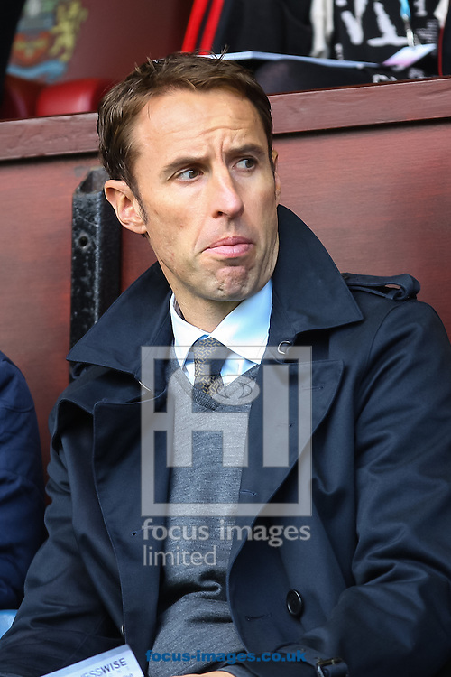 England Under-21 manager Gareth Southgate watches the Barclays Premier League match at Turf Moor, Burnley<br /> Picture by Daniel Chesterton/Focus Images Ltd +44 7966 018899<br /> 18/10/2014