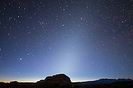 During the fall, the zodiacal light, or 'false dawn' shines brightly in the east before sunrise. It is caused by dust within our solar system reflecting sunlight. But it can only be seen in dark skies away from light pollution, which makes Arches National Park ideal.<br />
