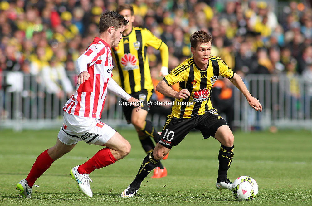 Phoenix' Michael McGlinchey dribbles the ball during the A-League football match between the Wellington Phoenix & Melbourne City, at the Hutt Recreational Ground, Wellington, 14 February 2015. Photo.: Grant Down / www.photosport.co.nz