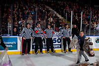 KELOWNA, CANADA - DECEMBER 2: Ice officials stand at the boards an wait for the ice to be cleaned from the annual teddy bear toss at the Kelowna Rockets against the Kootenay Ice on December 2, 2017 at Prospera Place in Kelowna, British Columbia, Canada.  (Photo by Marissa Baecker/Shoot the Breeze)  *** Local Caption ***
