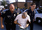 Anti-abortion protestors in Atlanta block health providers clinic doors and are arrested by uniformed Atlanta police.