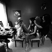 Ariel Zavala, center, works on her friend Alexis Berrios' makeup as Ariel's mother Monica, right, does her hair Saturday, April 30, 2016 in Tampa. Zavala who is transitioning from male to female attended her prom for Alonso High School on Saturday. CHRIS URSO/STAFF