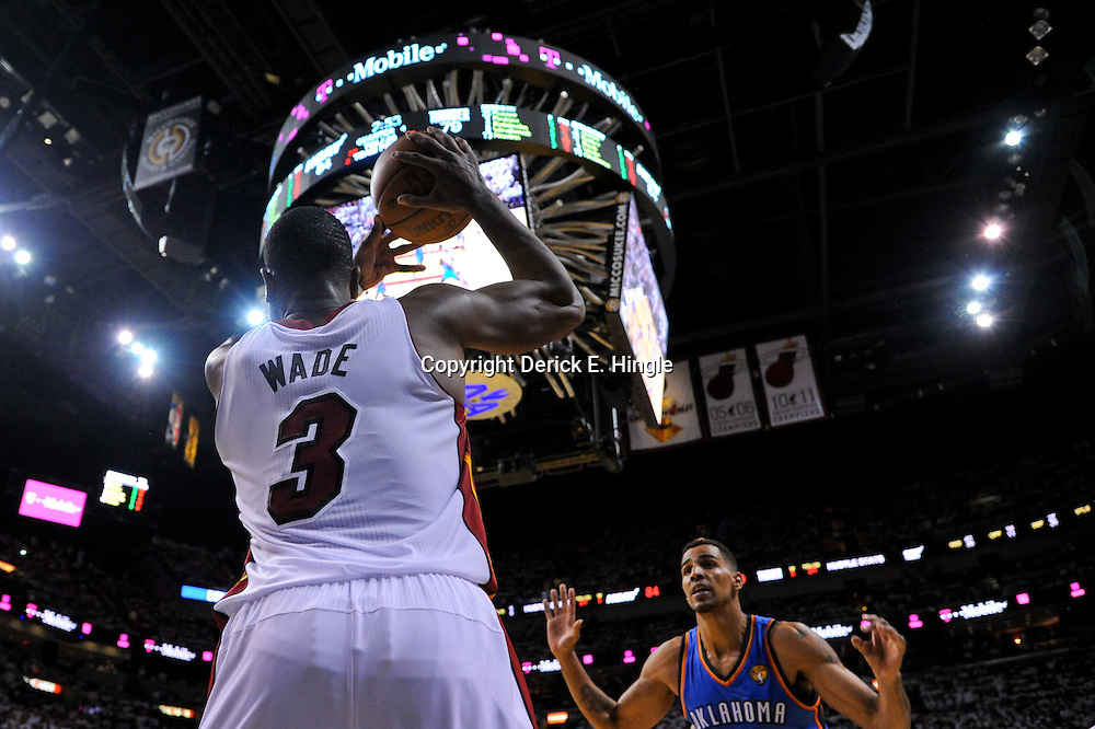 Jun 17, 2012; Miam, FL, USA; Miami Heat shooting guard Dwyane Wade (3) against the Oklahoma City Thunder during the fourth quarter in game three in the 2012 NBA Finals at the American Airlines Arena. Miami won 91-85. Mandatory Credit: Derick E. Hingle-US PRESSWIRE