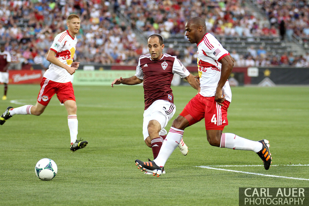 July 4th, 2013 - Colorado Rapids midfielder Nick LaBrocca (2) and New York Red Bulls defender Jamison Olave (4) battle for the ball in the first half of action in the Major League Soccer match between New York Red Bulls and the Colorado Rapids at Dick's Sporting Goods Park in Commerce City, CO