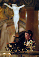 5 FEB. 2012 -- ST. LOUIS  -- Joseph Milner, a Boy Scout from St. Patrick Catholic Parish in Wentzville, Mo. reads from Colossians during a Scout Sunday prayer service at the Cathedral Basilica of St. Louis led by the Most Rev. Edward F. Rice, Auxiliary Bishop, Sunday, Feb. 5, 2012.  Photo © copyright 2012 Sid Hastings.